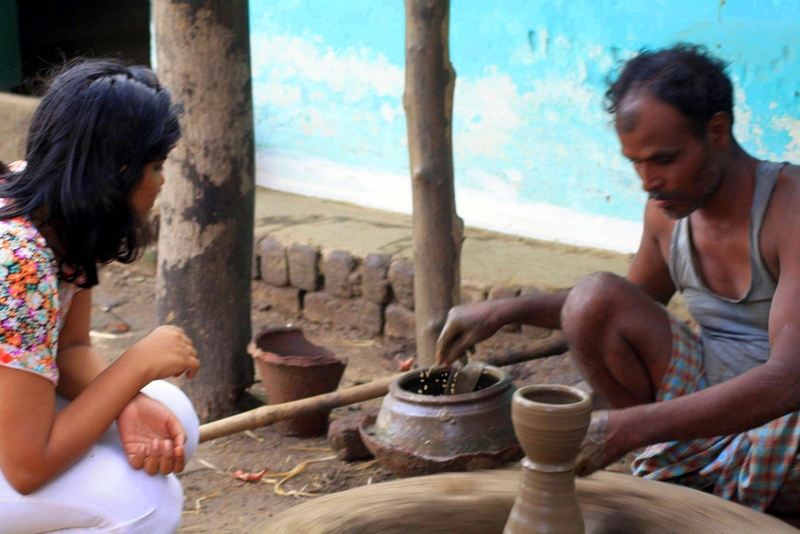 Learning pottery in the interiors of Khawasa village in India