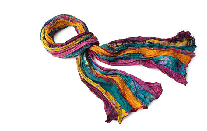 """Up-cycled"" from vintage saris in India, this gorgeous scarf is a patchwork of rich, jewel-colored pieces of luxurious silk."