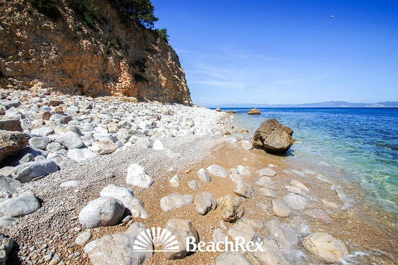 The Spanish town called L'Escala, or the ladder, has a beach called Cala Salpatx. It is not suitable for everyone, because first you have to walk around 750 metres and then climb down for 20 metres. You better bring your climbing shoes!