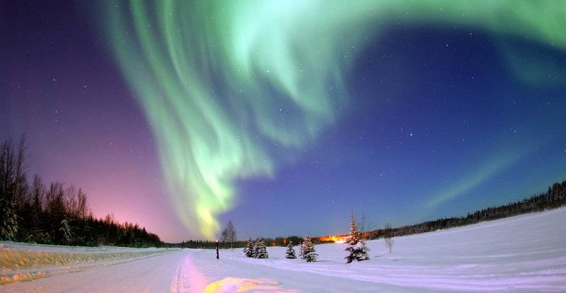 For those traveling through North America, the best places to see the Northern Lights include Calgary, Ontario, Yukon Territory, and Manitoba in Northern Canada, and Anchorage, Fairbanks, and Denali in Alaska.