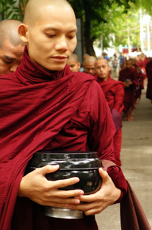 Giving of Alms at Mahagandhayon Monastery, Myanmar.