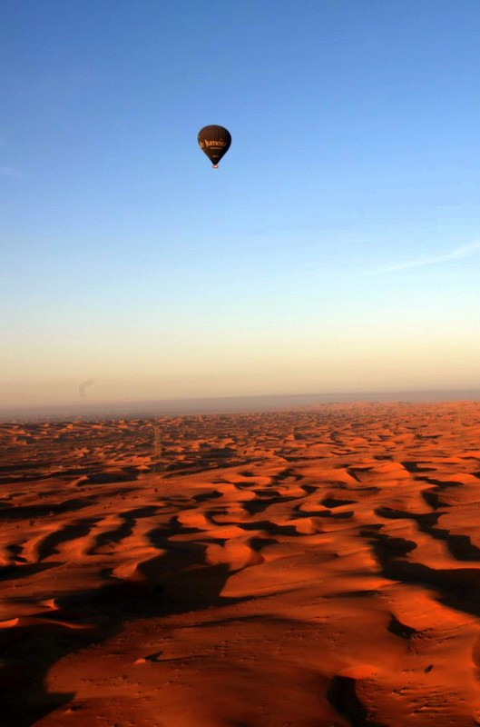 Enjoy the rare experience of seeing the fiery orange sunlight at the break of the dawn from high up in the air with a hot air balloon ride over Dubai.