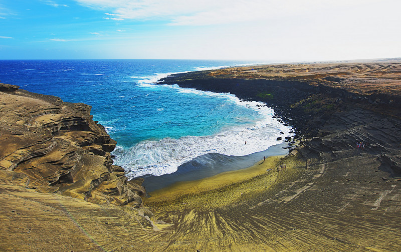 Papakōlea Beach is located in the Kaʻū district on the southern tip of the Big Island and is one of four beaches in the world known for their beautiful green sand (one of two in the USA).