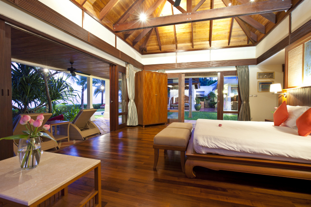 The four bedrooms of Villa Acacia are stunning with exposed timber ceilings, teak floors and fixed headboards with artwork.