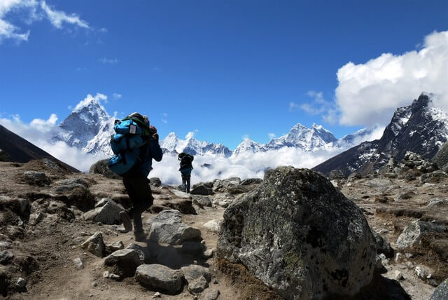 Porters trekking to Everest Base Camp