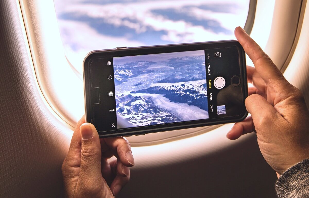 RF Phone filming airplane window