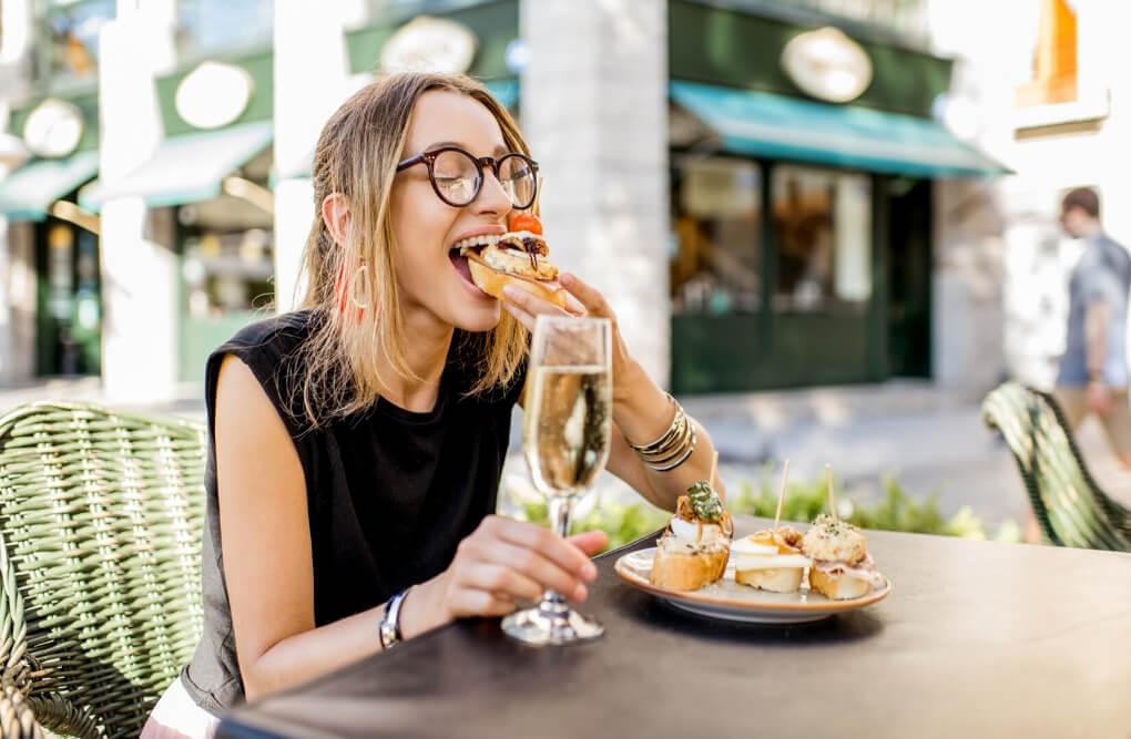 Food eating female traveler RF