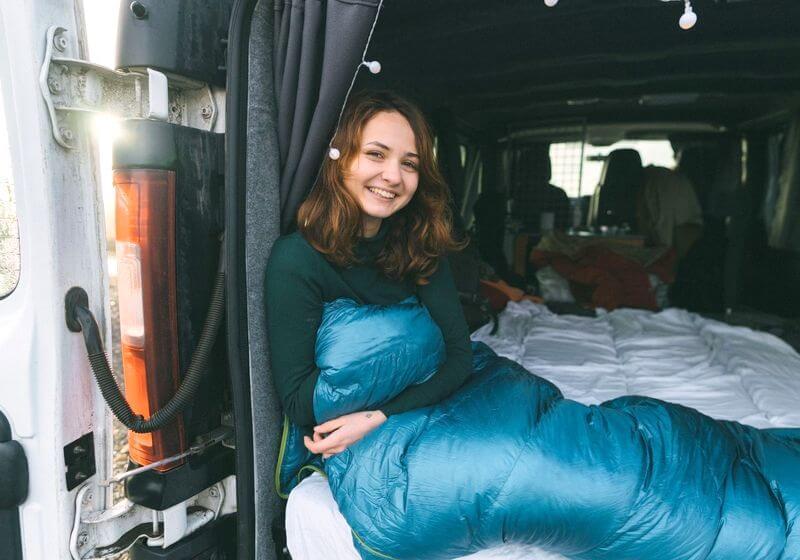 camp sleeping bag RV camper van woman RF