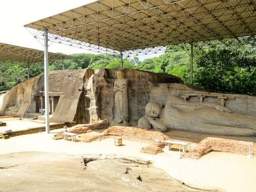 Massive stone carved Buddhas in Polonnaruwa
