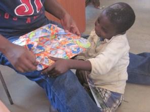 Malita receiving a present