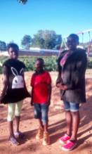 Three of the marajowi kids smiling at school