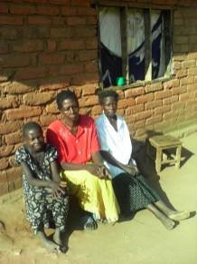Malita next to her mum and another woman
