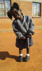 A smiling Stella is ready to go to nursery