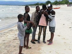 Checking pictures at Kande beach