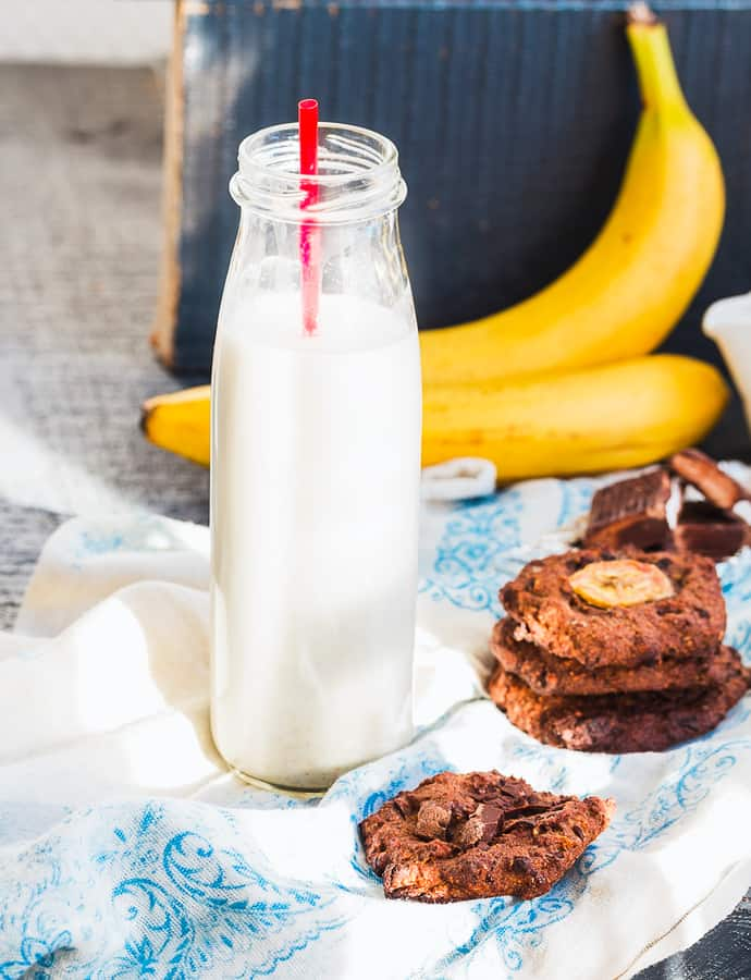 oatmeal cookies with chocolate and banana with almond milk blue wooden background sweet pastries