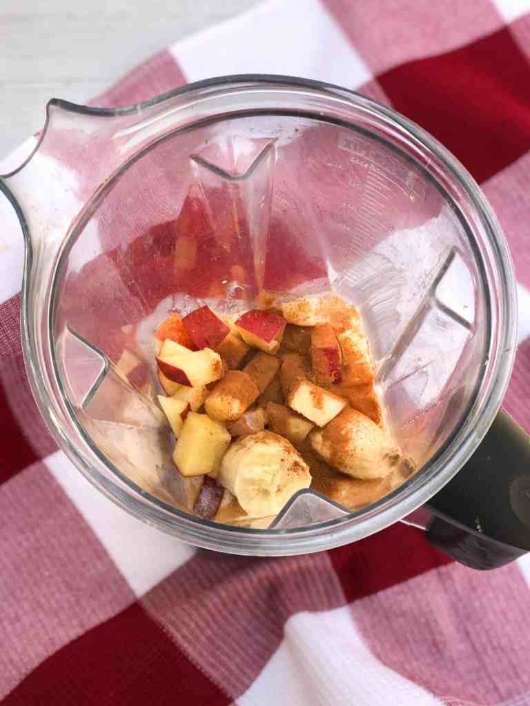 Ingredients for cinnamon apple banana smoothie bowl in blender