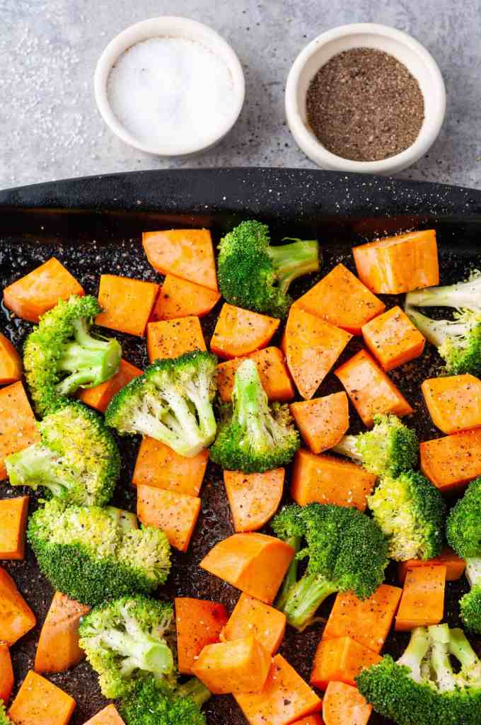 Closeup of broccoli and sweet potatoes with salt and pepper