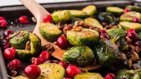 Closeup of Brussels sprouts and cranberries.