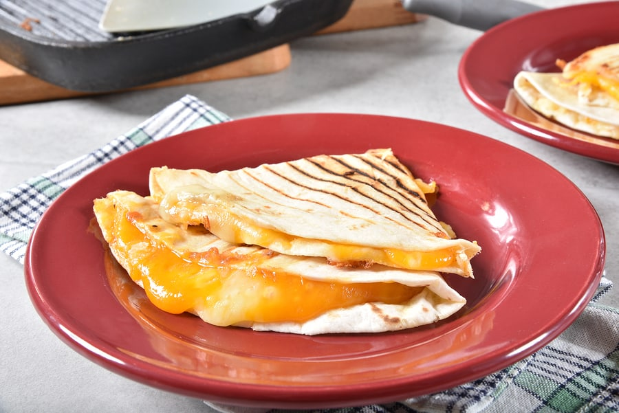 A fresh cooked over stuffed cheese quesadilla