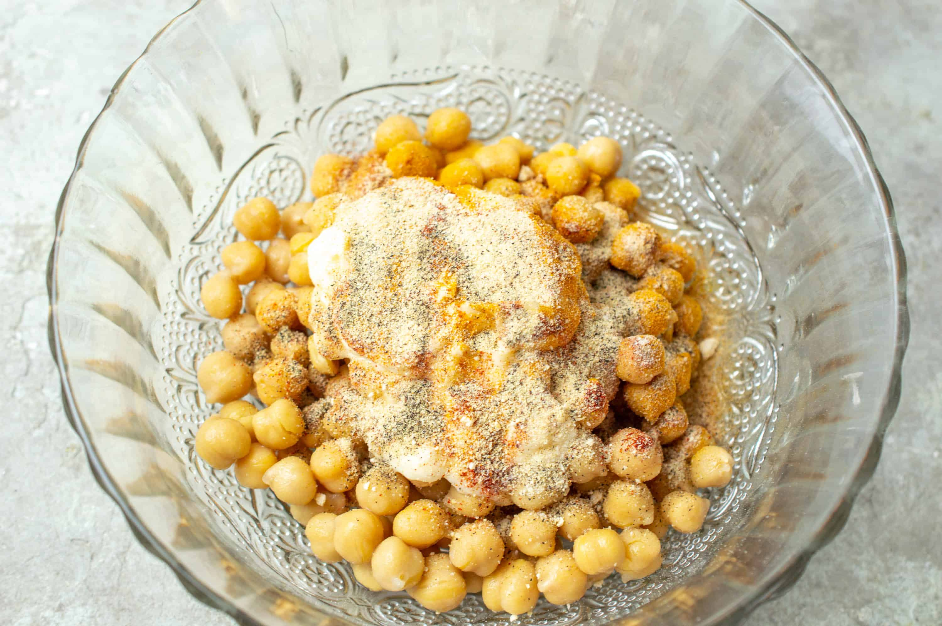 chickpeas in bowl with mayonnaise and spices