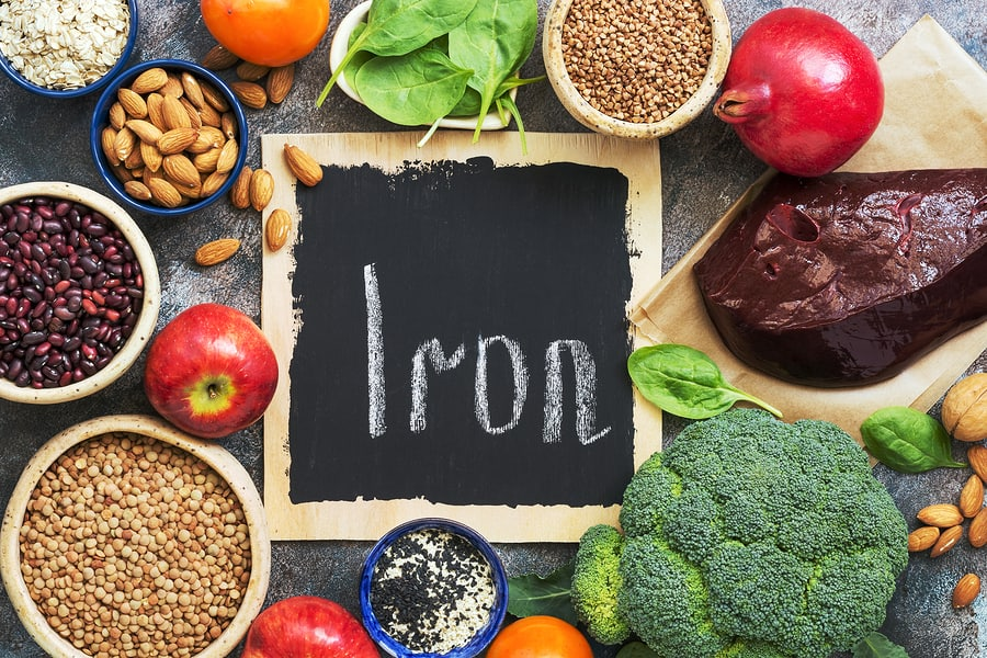 Foods high in iron. Vegetables, fruits rich in iron on a rustic background. Top view, flat lay, copy space