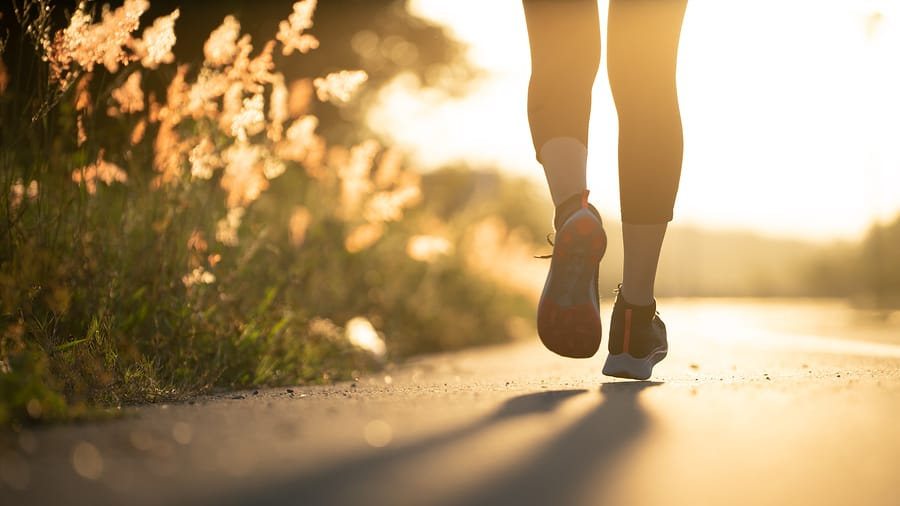 Young woman runner running on city bridge road, Young fitness woman runner athlete running at road