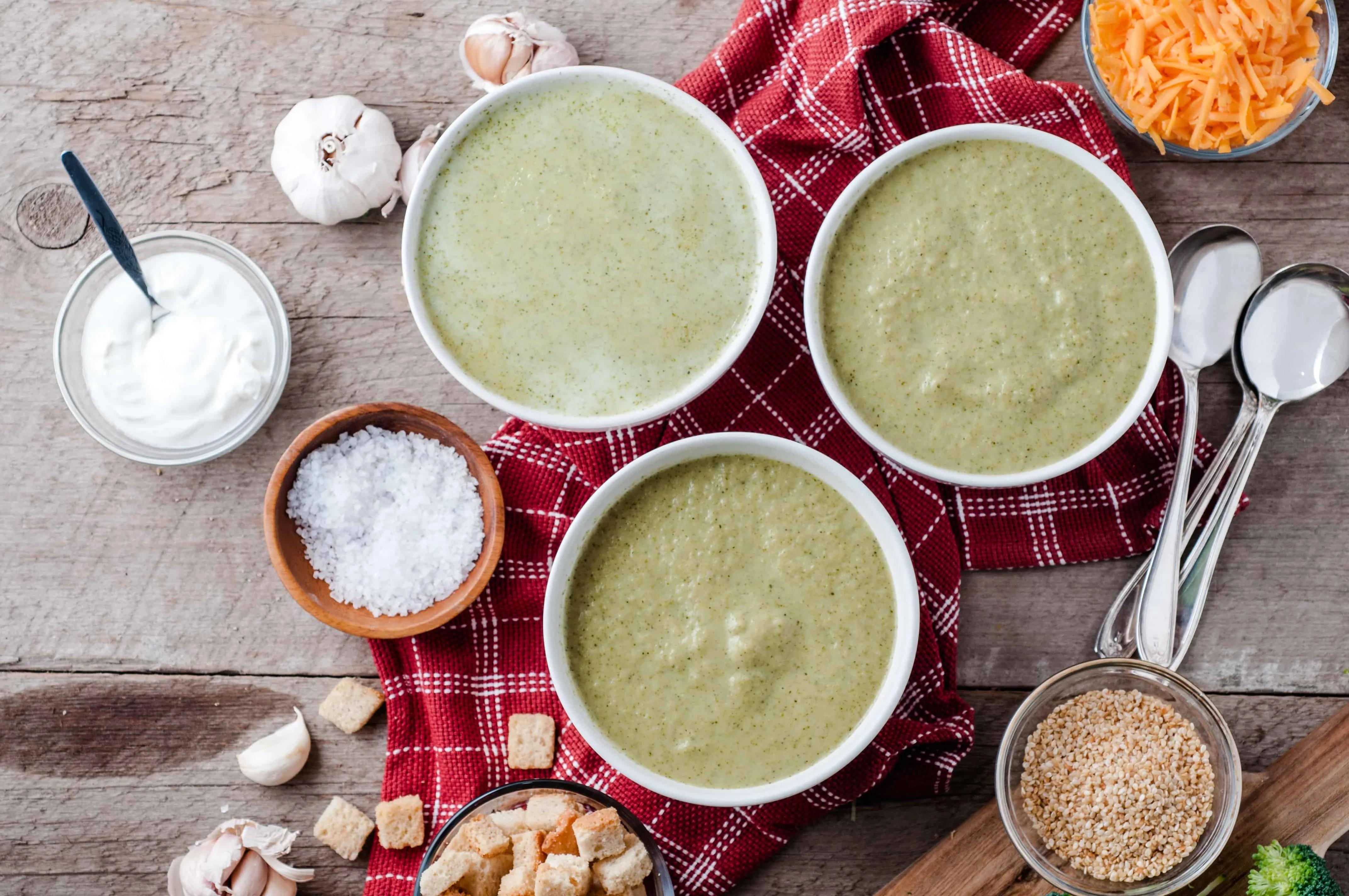 three bowls of Vegetarian Cream of Broccoli Soup