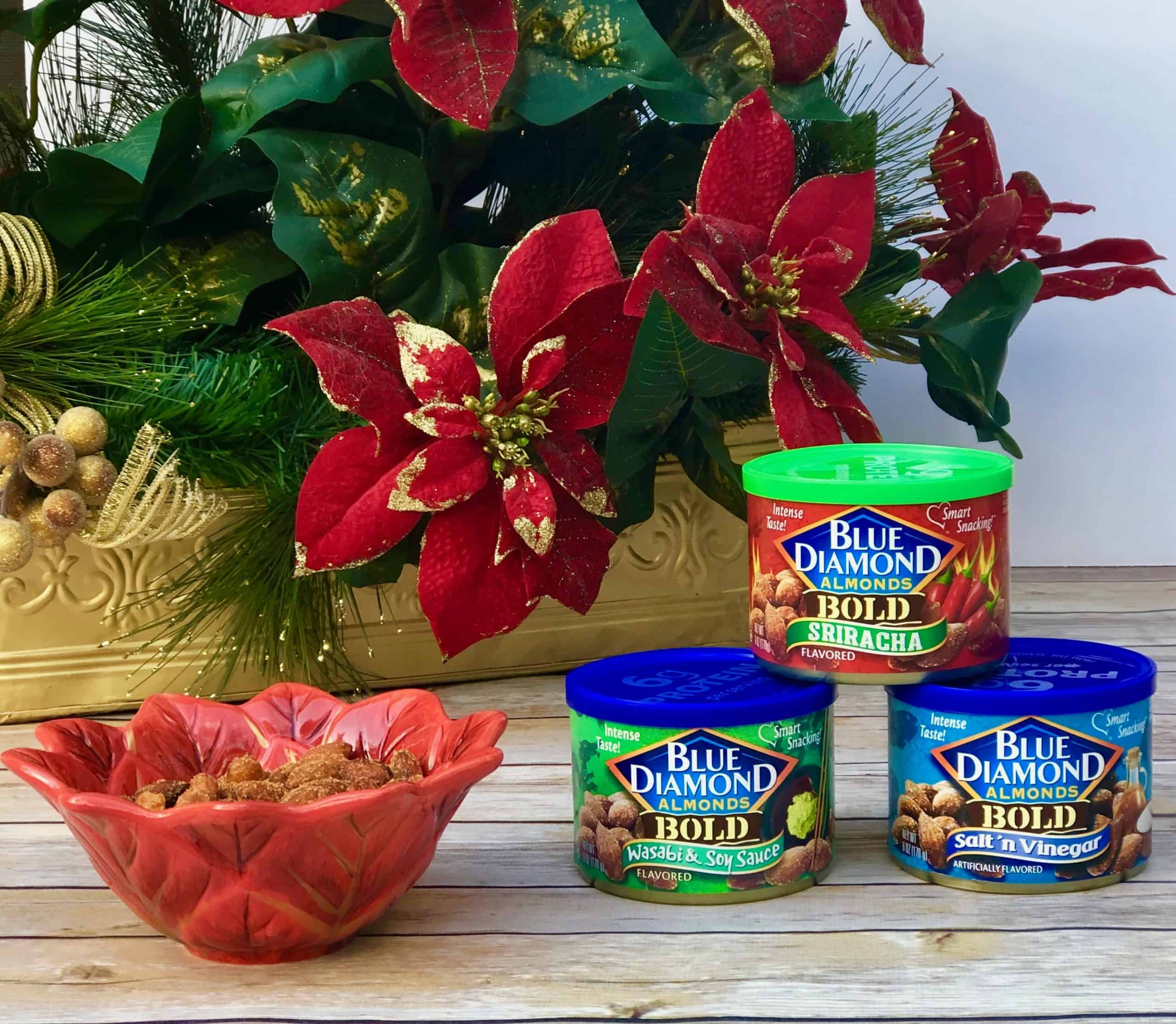 Blue Diamond Almonds in cans and in holiday bowl with poinsettias in background.