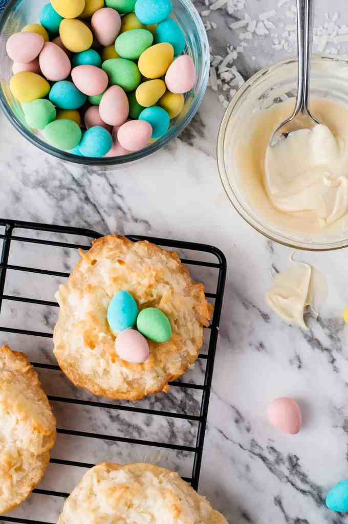Cadbury eggs, white chocolate and coconut cookies on a wire rack.