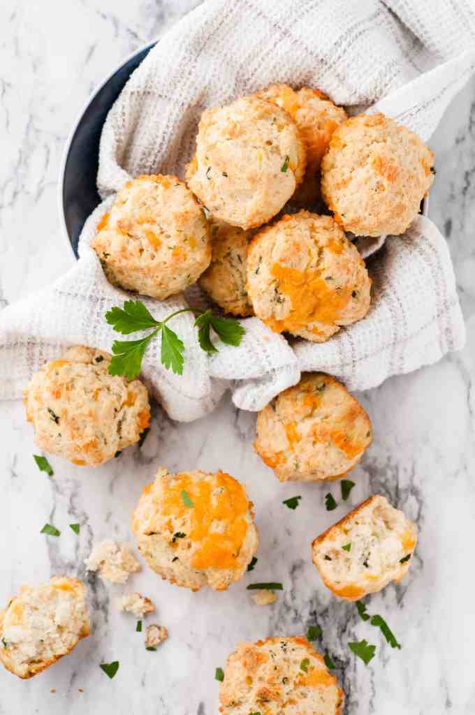 Cheese scones on a white marble background.