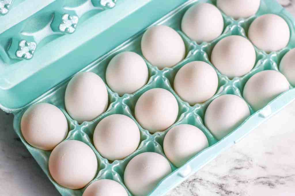 Eggs in a green styrofoam carton.