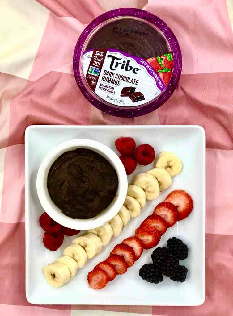 Tribe Chocolate Hummus with plate of fruit.