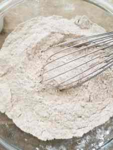 flour being whisked in a bowl.