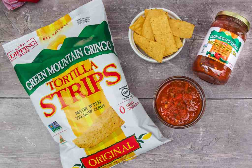 Green Mountain Gringo Tortilla Strips and Salas on a wood background.