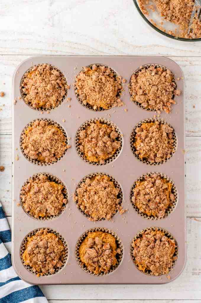 Whole wheat pumpkin muffins in a tin muffin pan ready to go in the. oven.