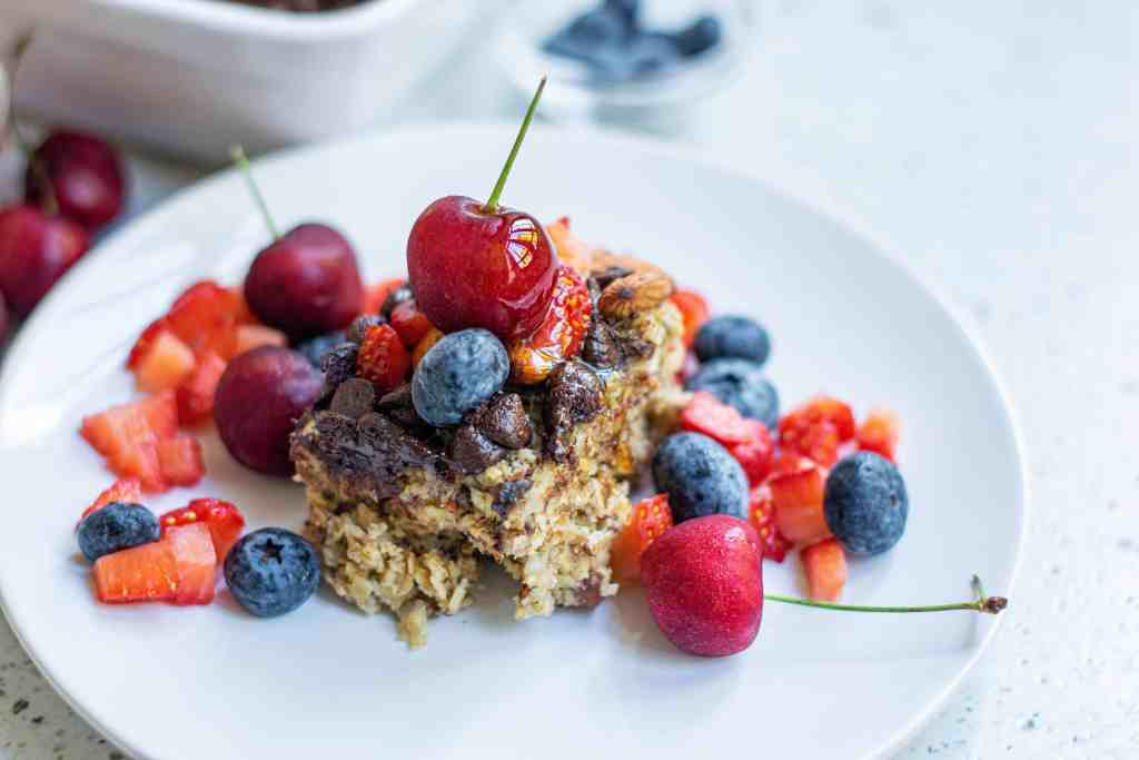 Vegan Baked Oatmeal with fruit on a white plate.
