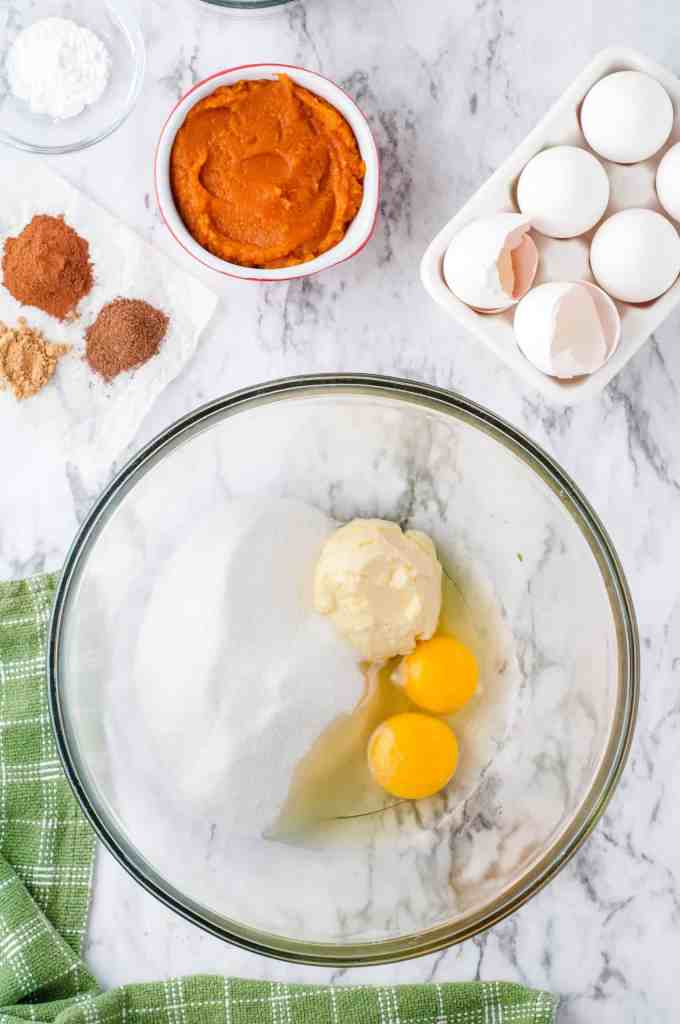 Eggs, butter, milk and flour in a bowl.