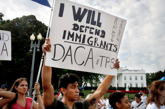 Judge temporarily blocks Trump from rescinding DACA