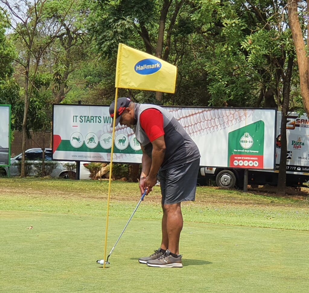 Saulos Chilima playing Golf