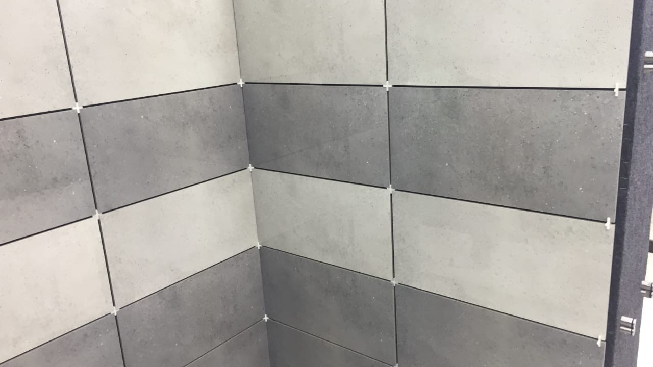 how to fix the grout cracking between
