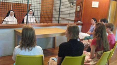 Dominican nuns speak to young women vocation retreatants.