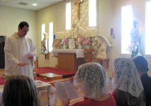 Fr. Ambrose Little, O.P. enrolls retreatants in the Angelic Warfare Confraternity