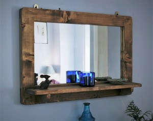 large wooden mirror with shelf