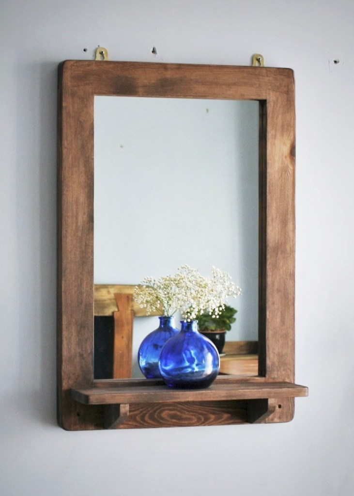 Our custom handmade wooden mirror with shelf measures 76 cm high x 52 cm wide and this modern farmhouse design with a rustic architectural twist is premium handmade by Marc Wood Joinery in Somerset UK from eco sustainable and reclaimed wood.