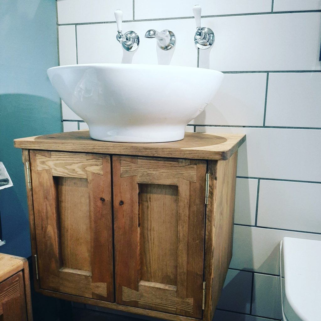 Bathroom sink stand in natural wood