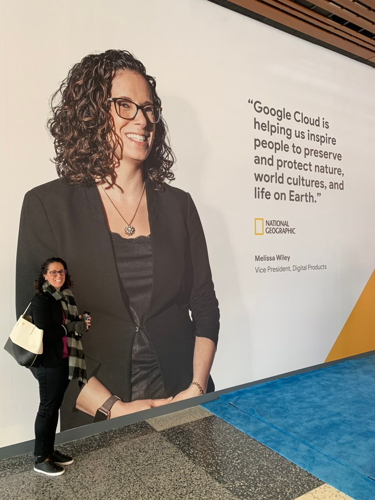 A picture of Melissa Wiley standing next to a poster of Melissa Wiley