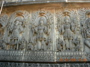 Temple carving at Hoysaleswara temple representing the Trimurti: Brahma, Siva and Vishnu.