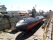 The Los Angeles class attack submarine USS Greeneville in dry dock, showing typical cigar-shaped hull.