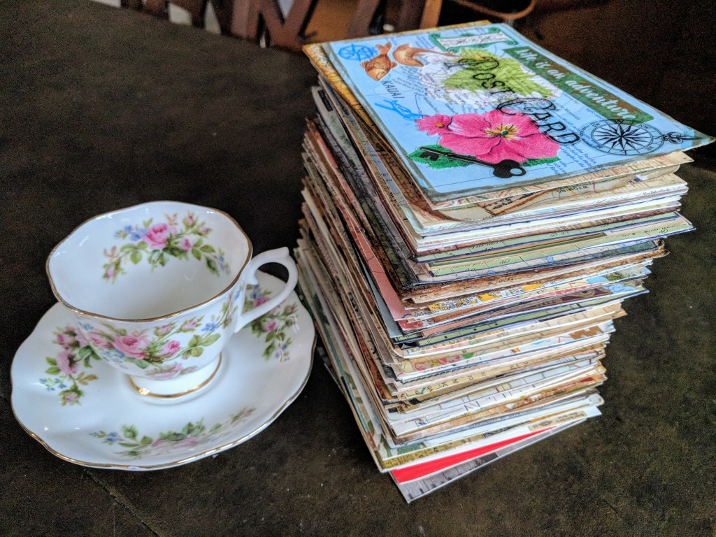 a foot-tall stack of collaged postcards