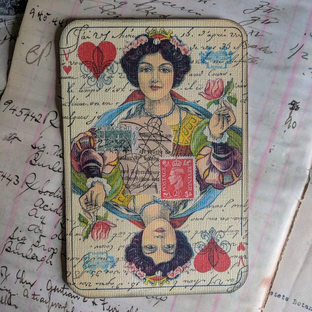 A collaged postcard featuring a large-sized queen of hearts.